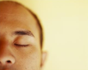 REM sleep is most easily recognized by the rapid and apparently random side-to-side movements of the closed eyes